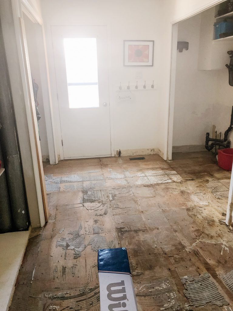 One layer down in the mudroom after tiles ripped up.
