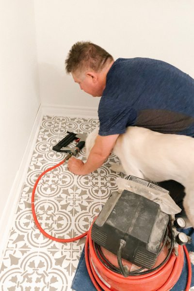 Always the helpful one, Lola assisted Geraint in installing baseboards in the laundry room.