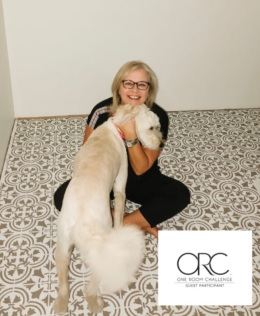 Leslie and Lola on the finalized stencilled tile floor