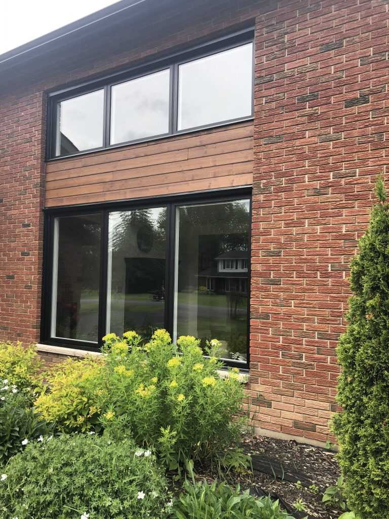 We are so pleased with the look of the two new black windows.
