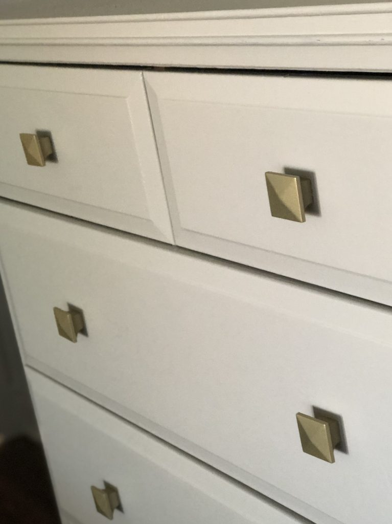 I spray painted all  of the different handles and knobs the same colour gold to unify them.