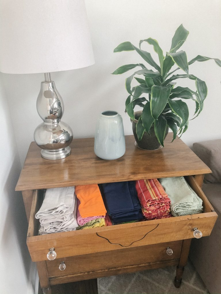 I use this traditional dresser in our modern living room for cloth napkin and table cloth storage