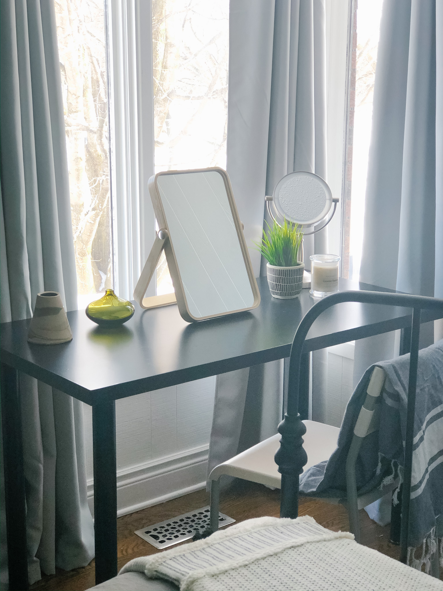 These inexpensive black-out drapes will darken the room when necessary but they pull back far enough to let the light in.