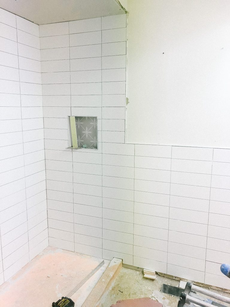 I love the crisp lines of stacked tiles and there is a sneak peak of the backsplash tile in the inset.