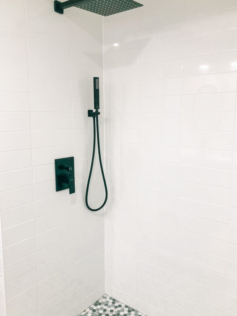 This shower system is a thing of beauty and so functional in our family bathroom