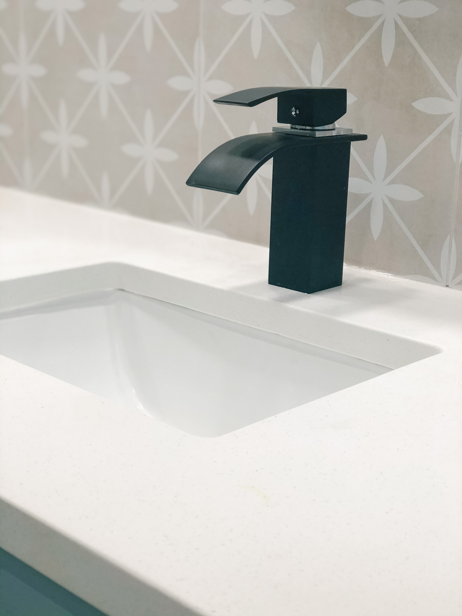 I just love this faucet.  It has a chalky feel and the water comes out in a flat waterfall.