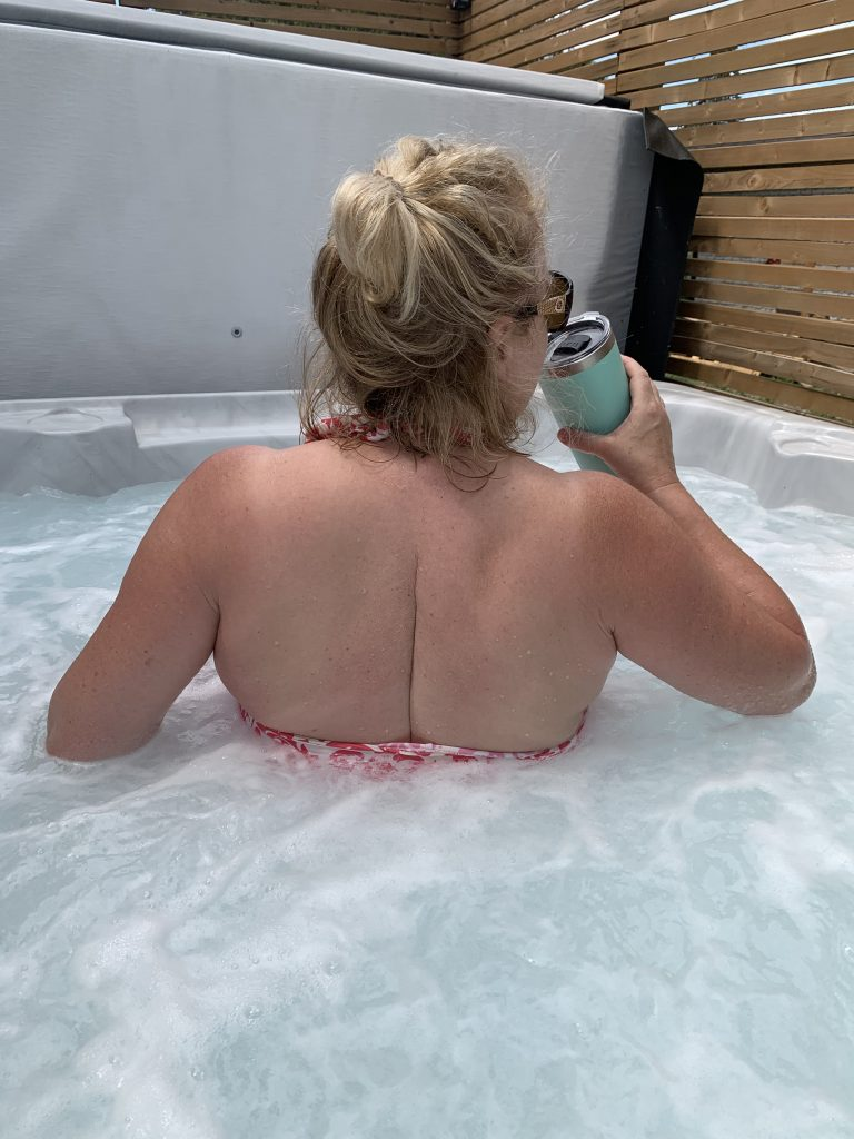 Here I am on a morning hot tub visit with my coffee.  This scar goes right to the base of my spine and has been open and closed three times.