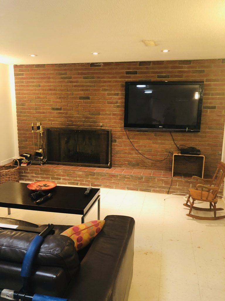 Here is another view of the sitting/tv watching area.  Hubby is hesitant to move the tv because he has already made holes in the brick with this installation.