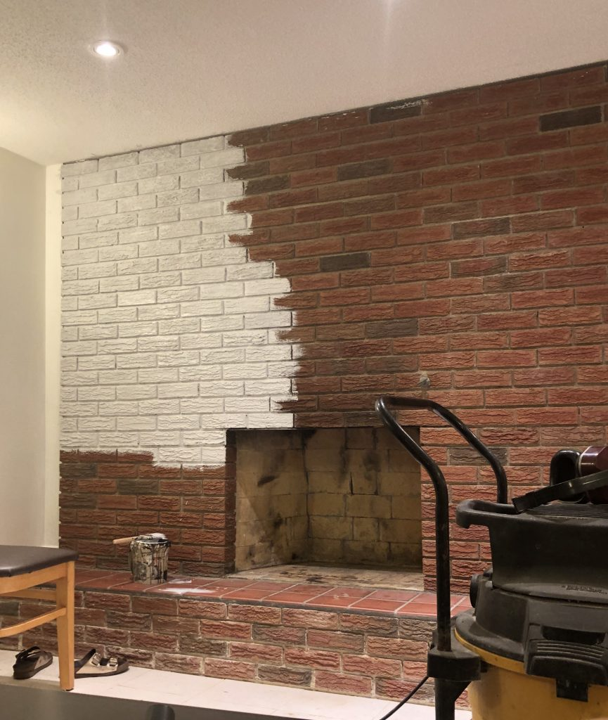 Painting the fireplace was a job and a half.  I really should have used a sprayer but over two days with a roller and a brush, I got it primed.