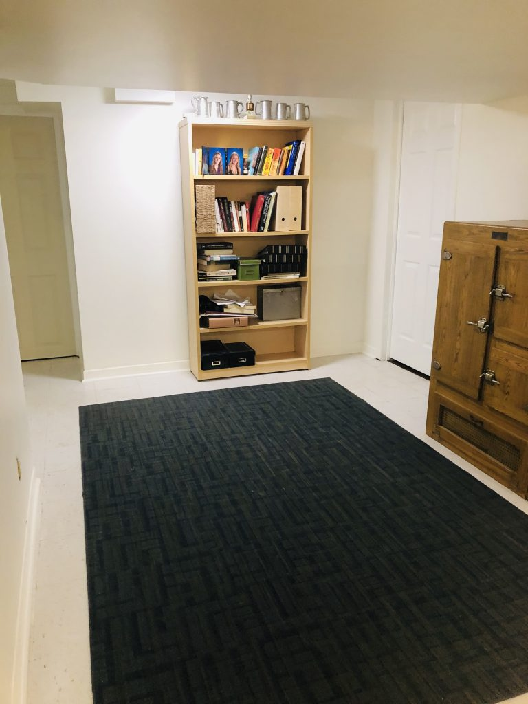 We had not touched this area in our home but it held this big book shelf and the cabinet where we store out photo albums