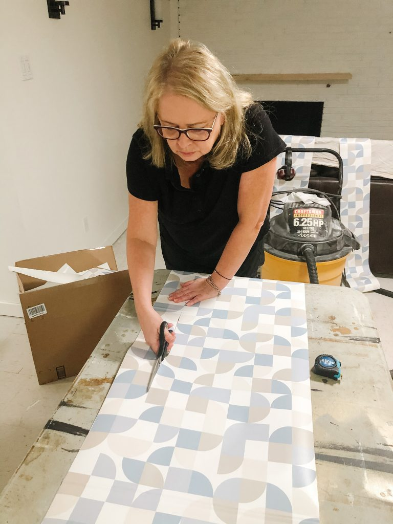 Cutting peel and stick wallpaper with a geometric patter like this is easier also.