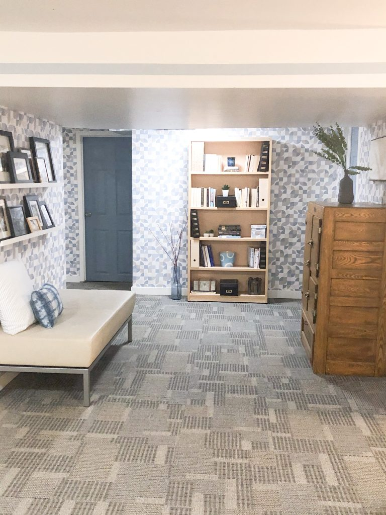 The peel and stick wallpaper transformed our library.