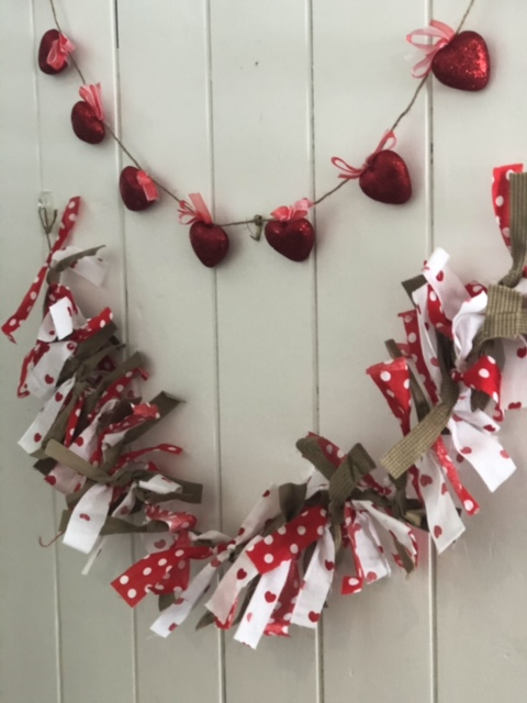 This garland that I made last year involved cutting pieces of fabric and tying them on to a twine.